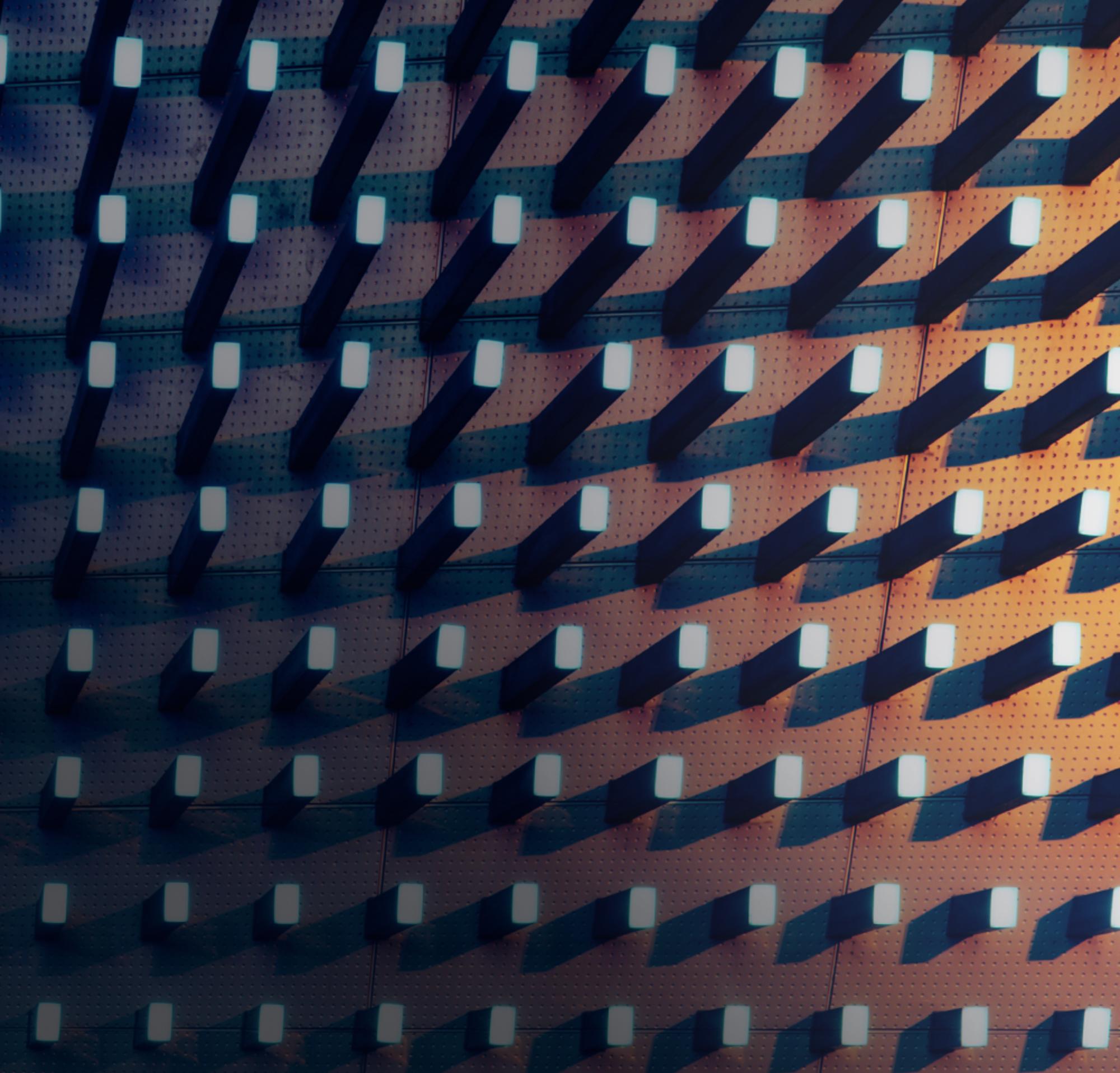 Tachuelas en un tablero con iluminación oscura